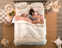 Aerial view of the Charity Bedding Collection, styled.
