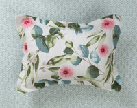 Sweeny Cotton Pillow Sham, a charming floral design in shades of green and pink on a white background pictured with the reverse, a light green geometric print
