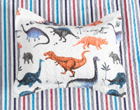 Bronto pillow sham featuring an array of dinosaurs in shades of red, grey and blue on a white background. Pictured on the reverse side of the coverlet which features a striped pattern in red and shades of blue.