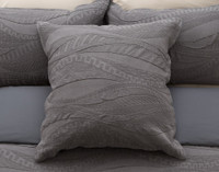 Noa Euro sham features geometric waves in shades of charcoal grey.