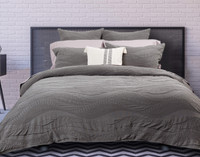 Noa Bedding Collection pictured with Bamboo Cotton pillowcases in Blush, a soft pink.