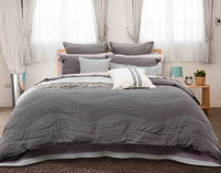 Noa Duvet Cover in varying shades of grey.