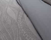 Close up the delicate wave pattern on the Noa Bedding Collection.