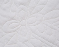 Close up of floral stitching on the Dominion White Floral Cotton Quilt Set.