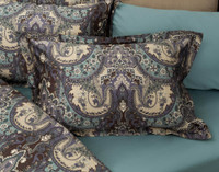 Tristan Paisley Pillow Sham, a classic and luxurious paisley in rich colours of chocolate brown, purple slate, and teal reversing to a complimentary mini link pattern, shown with coordinating pieces.