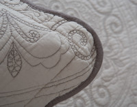 Detail of the hem on the Cavendish Cotton Pillow Sham - the collection is trimmed with dark brown cord.