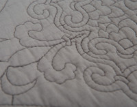 Close up view of the fleur-de-lis pattern on the Cavendish Cotton Quilt Set.