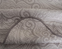 Detail of the hem on  the Cavendish Cotton Quilt Set - the collection is trimmed with dark brown cord.
