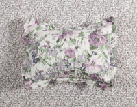 Brittany Floral Pillow Sham featured on the reverse side of the coverlet.