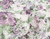 Close up of purple and green floral print on the Brittany Floral Coverlet Set.