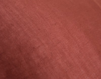 Close up of taut Linen Blend Fabric in Apple Butter Red