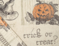 Close up of a jack o' lantern on the Haunting Halloween Fleece Throw.