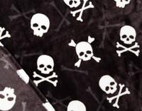 Close up pattern on Skull & Bone Halloween Fleece Throw.