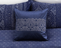 Blue polyester velvet square pillow embroidered with silver tribal border.