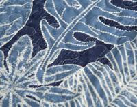 Close up of botanical print on Anup Coverlet Set.