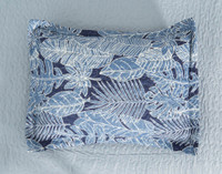 Anup Pillow Sham featuring a blue botanical print of various tropical leaves.