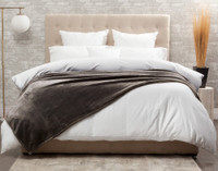 The Cashmere Touch Fleece Blanket pictured in Porcini, a greyish brown.