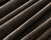 Close up of texture on Cashmere Touch Fleece Blanket in Porcini Brown.
