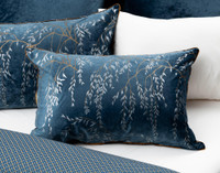 Panache Pillow Shams in Teal shown on bed.