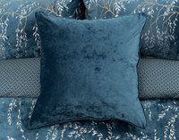 Euro shams are a solid coordinate teal velvet and are finished with a piped trim.