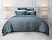 Panache Bedding Collectionreverses to a geometric print in teal and gold.