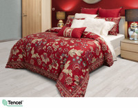 Side profile view of the Stratford Duvet Cover, a red background covered in gold and blue floral print.