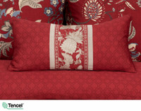 Stratford Boudoir Cushion Cover pictured with accompanying duvet cover and pillow shams.