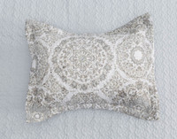 Adan Pillow Sham features off-centre medallions in mixed shades of grey and brown on a white background.