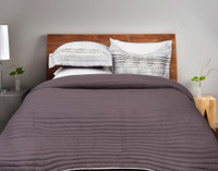 Nitva Coverlet Set reverses to a solid grey with purple undertones.