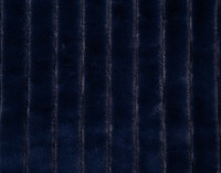 Close up of channels in the Ribbed Faux Fur Throw in Midnight, a deep navy blue.