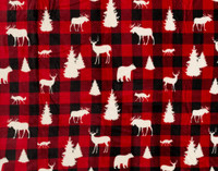Zoomed out view of red and black plaid print featuring cream coloured woodland creatures.
