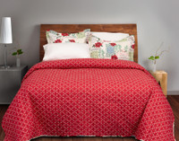 Noel Coverlet Set reverses to a bold red with cream filigree design