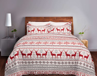 The Prancer Coverlet Set, featuring red reindeer and snowflakes alongside bold grey and red geometric print on a white background.