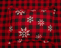 Snowflakes Pillow Sham featuring white snowflakes on a classic red and black plaid print.