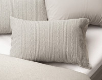 Estevan Pillow Sham pictured with Eucalyptus Luxe sheeting in white.