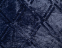 Close up of pattern on Diamond Etch Throw in navy, a deep blue