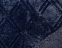 Close up of pattern on Diamond Etch Throw in navy, a deep blue and sherpa reverse