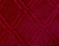 Close up of pattern on Diamond Etch Throw in Ruby, a vivid red