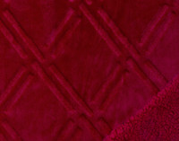 Close up of pattern and sherpa reverse of Diamond Etch Throw in Ruby, a vivid red