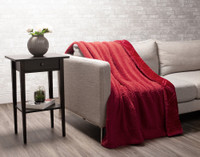 Sherpa reverse of Diamond Etch Throw in Ruby, a vivid red