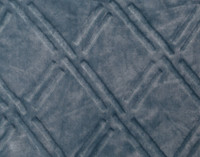 Close up of pattern on Diamond Etched Throw in Tidewater, a soft blue