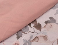 Carley Duvet Cover Set reverses to a soft coral pink.