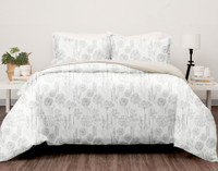 Olympia Duvet Cover Set features sketchbook florals in greyscale on a white background.