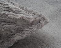 Close up of trim on Faux Rabbit Plush Pillow Sham.