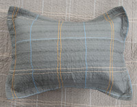 Roma Cotton Pillow Sham, featuring an orange and blue plaid on a grey background.