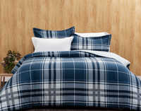 The Ashton Oversized Cotton Comforter Set, featuring a classic plaid print in blue on white.