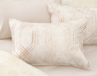 Mirasol Pillow Sham in beige with gold pattern on bed