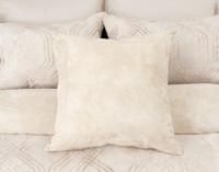 Mirasol Euro Sham in soft sandstone colour on bed