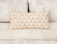 Mirasol Boudoir Pillow with gold embroidery on bed