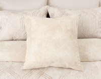 Mirasol Euro Sham in soft sandstone colour on bed
